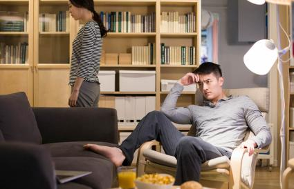 Angry couple in living room