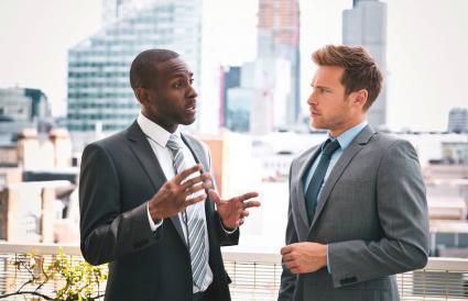 Two professional businessmen talking