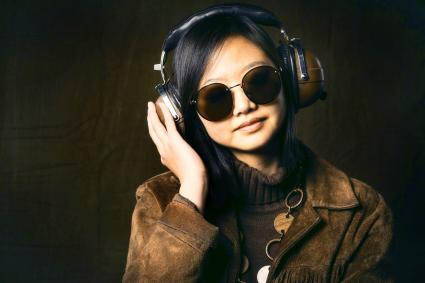 Woman wearing vintage clothing and headphones