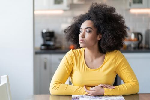 Woman sitting in kitchen