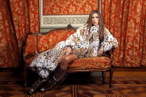 Woman lounging in lynx coat