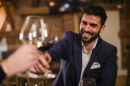 Man toasting with wine glasses