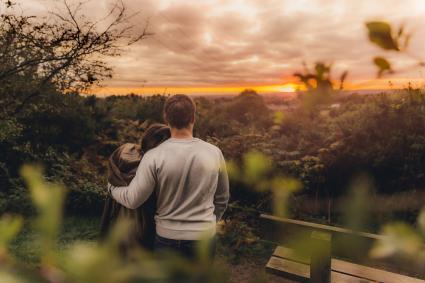 Man and woman enjoying sunset