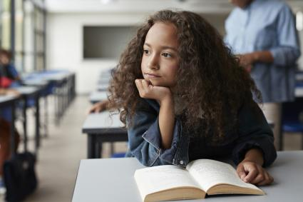 Girl daydreaming in classroom
