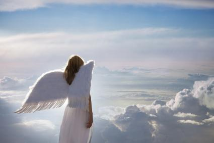 Angel standing on clouds