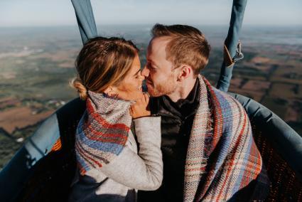Couple enjoying a balloon ride