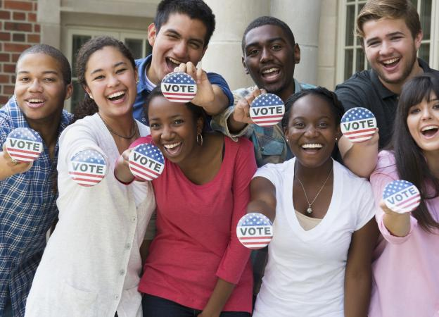Group of people holding Vote buttons