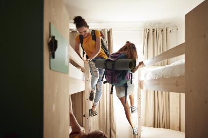 Girls climbing into bunk beds