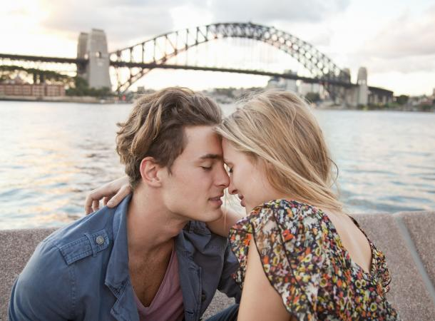 Couple embracing near Sydney Harbour Bridge