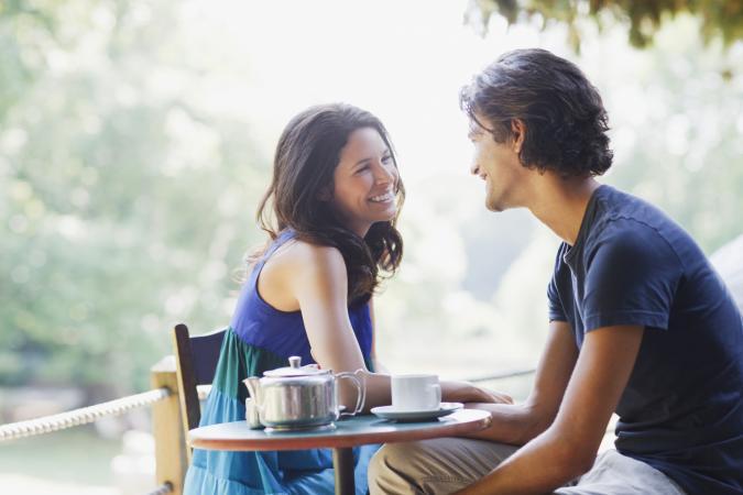 Couple having tea outdoors