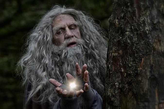 Wizard with light in hands, casting a spell