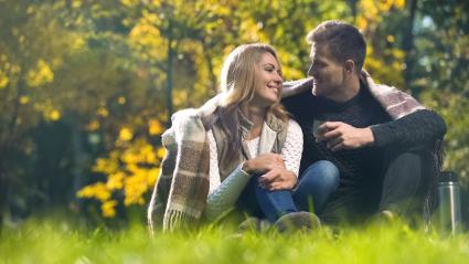 Man and woman enjoying conversation outdoors