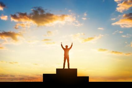 Man with arms raised in triumph
