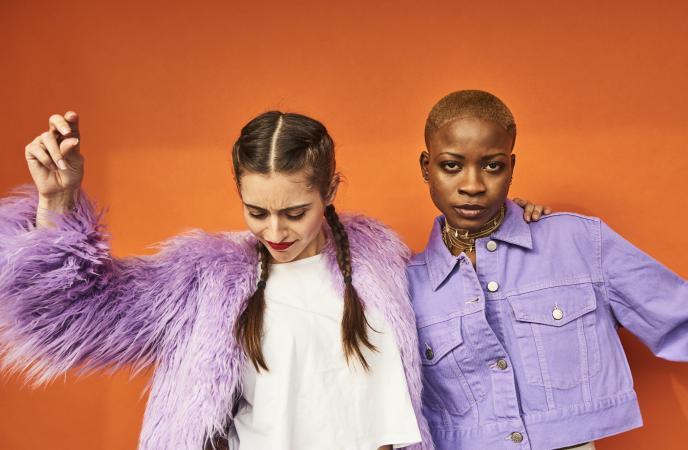 Two friends dressed in purple