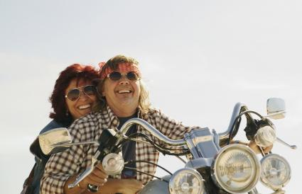 Mature couple on motorbike