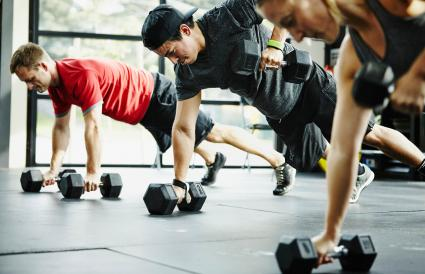 Group of friends doing pushups