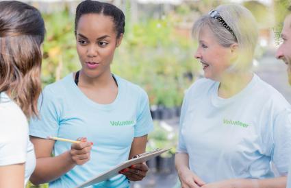 Woman market volunteers