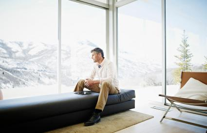 Man on couch in modern home