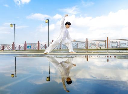 Chinese woman practices tai chi