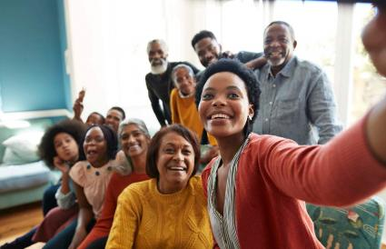 woman taking selfie with family