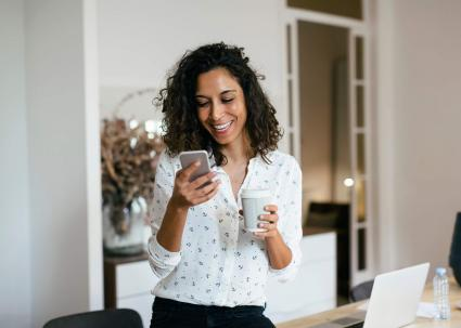 woman in office using smart phone
