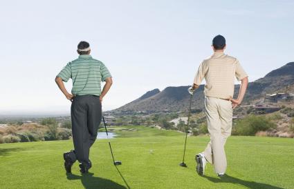Hispanic men playing golf