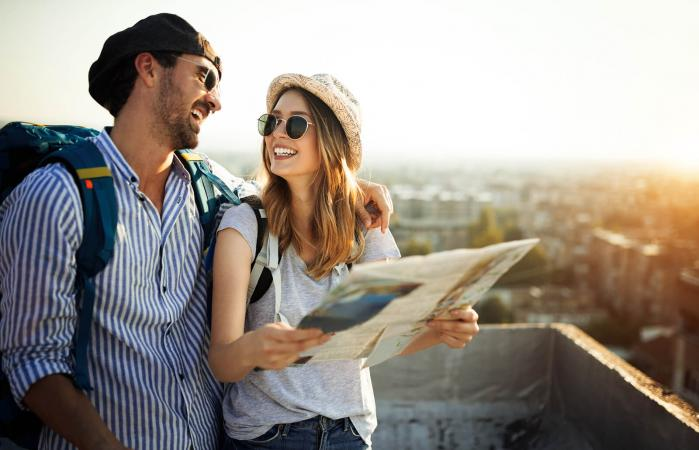 couple traveling with a map