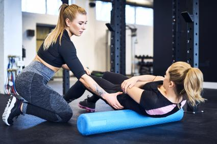 Woman with personal trainer in a gym