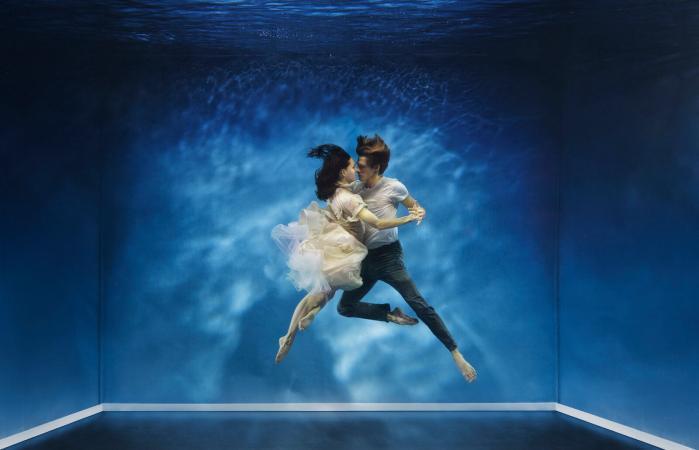 couple dancing under water
