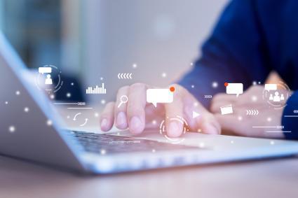Man using laptop and social media