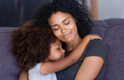 daughter embracing mother