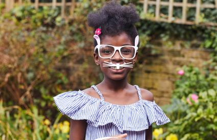 child wearing Easter bunny glasses