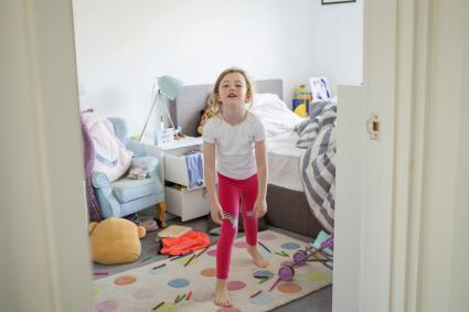 Young girl having tantrum in bedroom