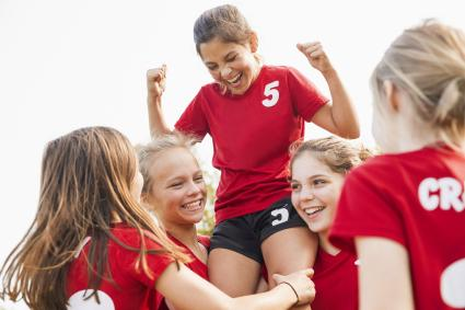 Girls soccer team celebrating victory