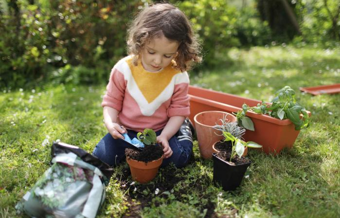 little girl potting plants