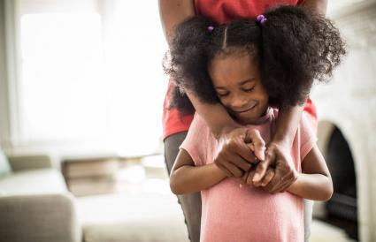 Mother's arms embracing daughter