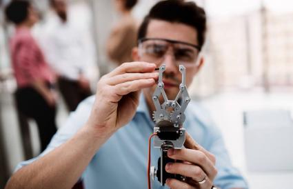 scientist with robotic hand
