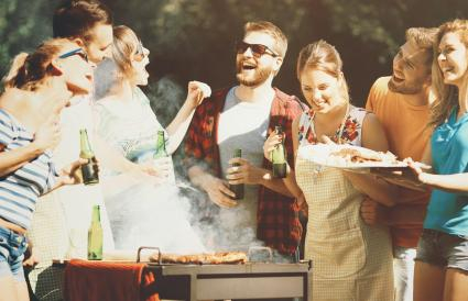 friends having backyard barbecue party