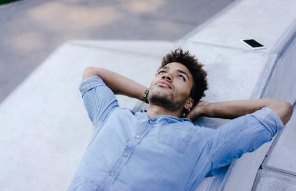 relaxed man lying in skatepark