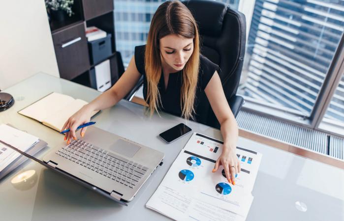 Businesswoman reading financial report