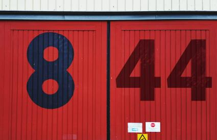 Numbers on red metallic door