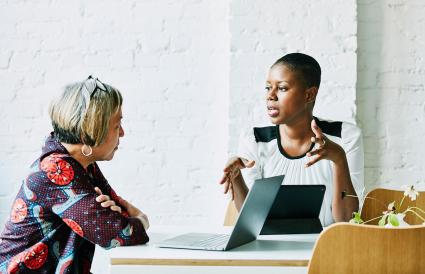 Woman in discussion with client