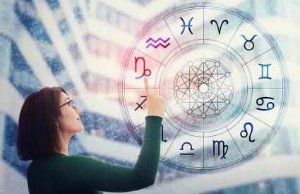 Woman choosing a zodiac sign