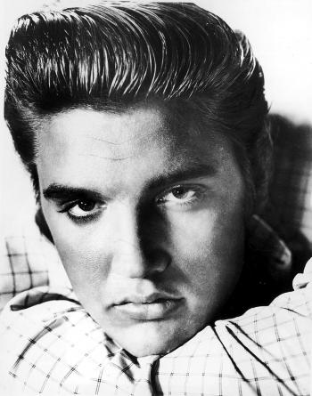 Elvis Presley poses for a portrait circa 1955