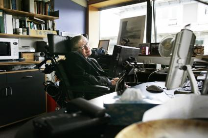 Professor Stephen Hawking, poses for photographs in his office at The Centre for Mathematical Sciences in Cambridge