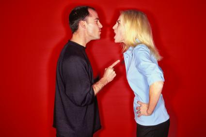 Couple arguing in a red background