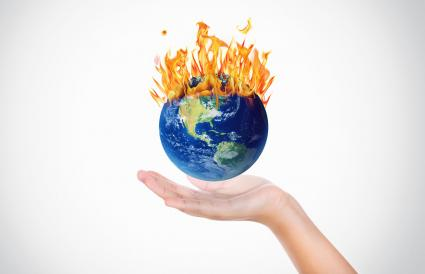Hands holding a globe on fire