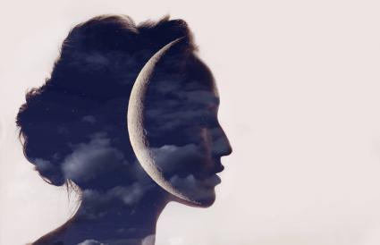 woman profile with moon in head