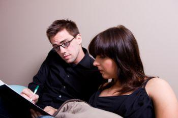 Couple studying numerology results.
