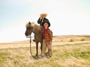Boy and girl on Shetland pony